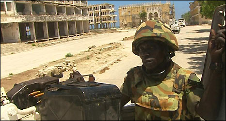 Ugandan African Union peacekeeper patrols ruined Mogadishu