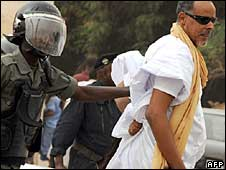 A policeman and a protester in Mauritania's capital, Nouakchott