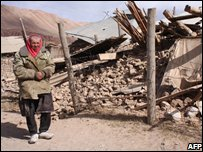 A Kyrgyz man near a house destroyed by the earthquake in Nura on 6 October 2008.