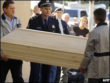 The coffin of Ivana Hodak is carried out of her apartment block in Zagreb on 6/10/08