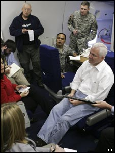 US Defence Secretary Robert Gates addresses a press conference on board a plane on Monday 6 Oct 2008