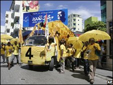 Opposition Maldivian Democratic Party supporters campaign in the capital, Male