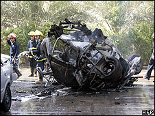 Fire-fighters put out a blaze in a burning car