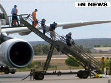 Pictures of passengers getting off Airbus at Learmonth Airport (Picture: Channel 9)