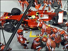 Felipe Massa accelerates away from the Ferrari pit in Singapore