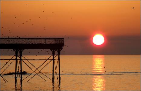 The sun sets over Aberystwyth pier
