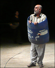 Oil-barrel man, from play by Haider Munathir