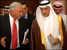The director of the International Monetary Fund (IMF) Dominique Strauss-Kahn (L) walks with Saudi Finance Minister Ibrahim al-Assaf