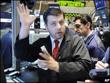 Specialist Igor Lerner, left, directs trades at his post on the New York Stock Exchange floor