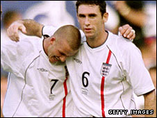 Martin Keown celebrates England's draw with Greece in 2001 with David Beckham