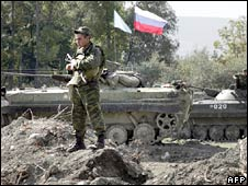 Russian troops dismantle a checkpoint near South Ossetia. Photo: 7 October 2008