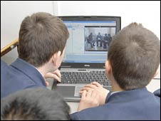 Pupils use a computer at school. File photo