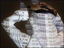 Saudi trader watches stock market monitor