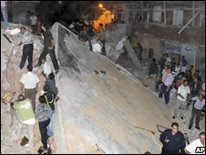 Rescue workers at the site of the collapsed apartment building in Alexandria, Egypt