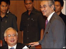 Malaysian Prime Minister Abdullah Ahmad Badawi, right, talks to his deputy Najib Razak (left)