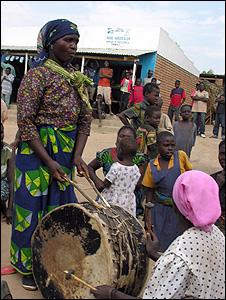 Women banging drums (Image: BBC)