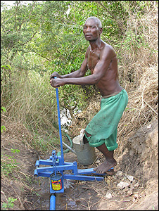 Man operating a foot irrigation pump (Image: BBC)