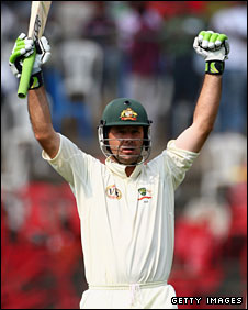 Ricky Ponting raises his arms after reaching his century