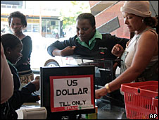 Shoppers at a supermarket selling products in US dollars