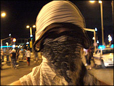Person with face covered during rioting in Acre, 8 October 2008 (Image: www.panet.co.il)