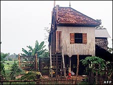 A separated Cambodian couple cut their house in half