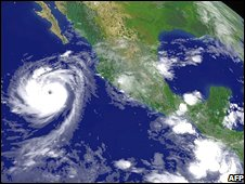 Hurricane Norbert (left) churns up the Pacific off Mexico on 8 October in this Nasa satellite photo