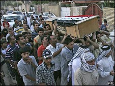 Relatives carry the coffin of Iraqi politician Saleh al-Ogaili in Baghdad