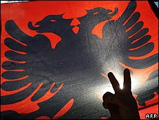 An ethnic Albanian celebrates Kosovo's independence in Mitrovica (February 2008)