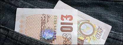 British bank notes in a pocket