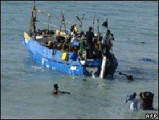 Refugees on a boat leaving Bossasso, Somalia (file image)
