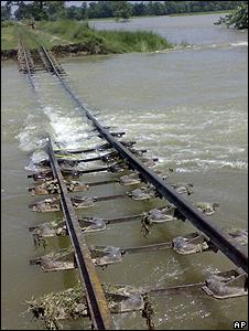 Flooded railway embankment (Image: AP)