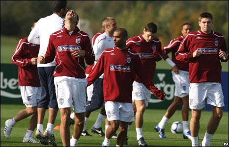 England's Rio Ferdinand (left) laughs as he warms up with Ashley Cole (centre) and Steven Gerrard (right)
