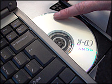 A laptop and CD