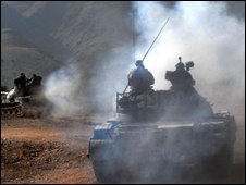 Pakistani soldiers on patrol during a military operation against Islamic militants in Dara Adam Khel near Peshawar on September 29, 2008.