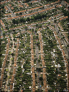 Aerial view of houses (Science Photo Library)