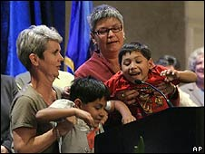 Plaintiffs in the case Elizabeth Kerrigan (L) and Joanne Mock with their twin sons