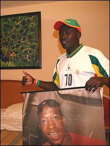 Samba Gningue with a poster of his hero Khalilou Fadiga