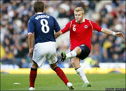 Norway's John Arne Riise clears the bar