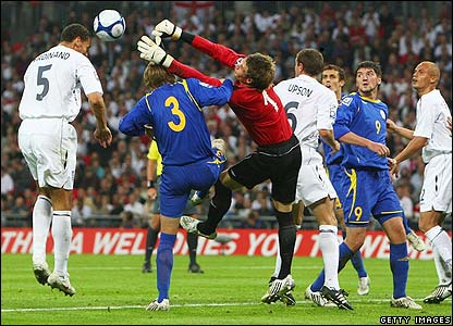 England captain Rio Ferdinand heads into an empty net