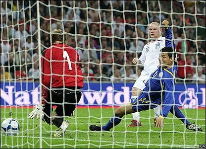 Rooney scores his second of the night