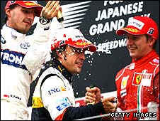Robert Kubica, Fernando Alonso and Kimi Raikkonen on the podium after the Japanese Grand Prix