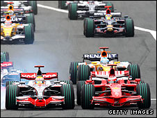 McLaren's Lewis Hamilton (left) attempts to pass Kimi Raikkonen of Ferrari