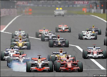 Lewis Hamilton (left) and Kimi Raikkonen race side by side as they enter the first corner