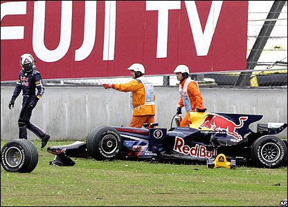 David Coulthard walks away from the wreckage of his Red Bull