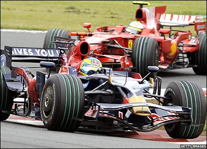 Sebastian Bourdais of Toro Rosso leads Felipe Massa of Ferrari