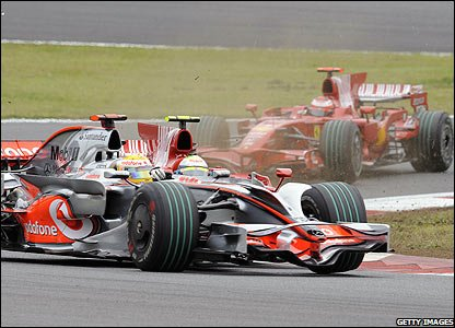 Lewis Hamilton (left) and Felipe Massa collide on lap two in Fuji