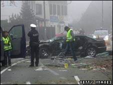 Police near the wreckage of the car Joerg Haider was driving, 11/10/08