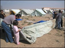 Displaced Christians set up camp in a soccer stadium at Burtulla, outside Mosul, on Sunday 12 October 2008