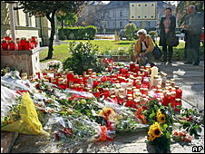 Mourners lay flowers and candles outside Carinthia regional government HQ in Klagenfurt