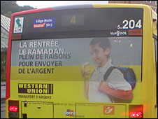 Bus in Liege, featuring ad aimed at immigrants